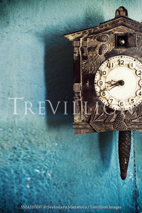 Svetoslava Madarova cuckoo clock on blue wall Miscellaneous Objects