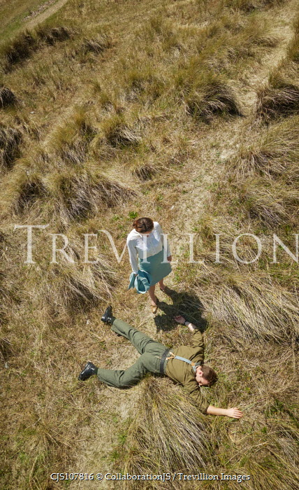 CollaborationJS aerial shot of a dead man found on a country path Groups/Crowds