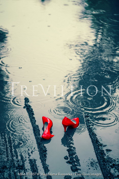 Magdalena Russocka red stilettos abandoned in puddle Miscellaneous Objects