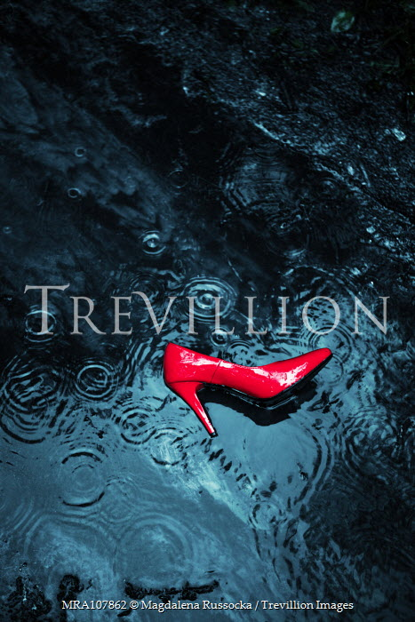 Magdalena Russocka red stiletto abandoned in puddle Miscellaneous Objects