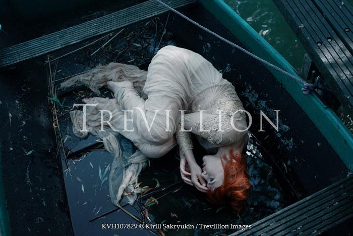 Kirill Sakryukin Woman lying in wet boat Women