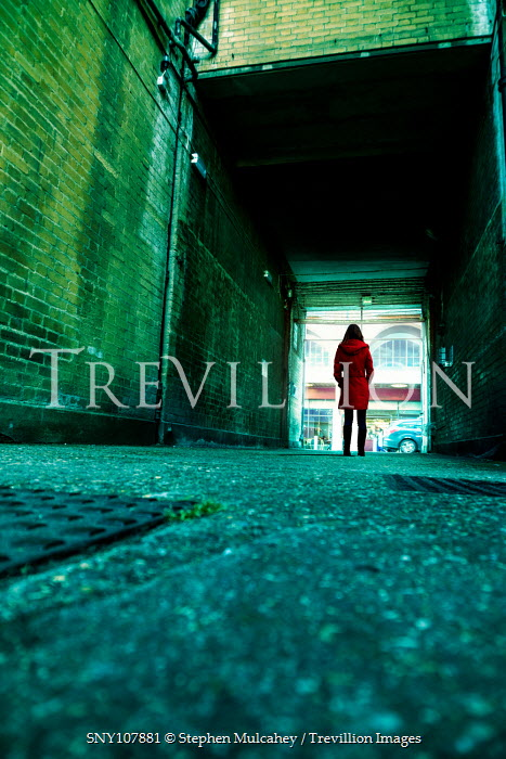 Stephen Mulcahey Woman standing in covered alleyway
