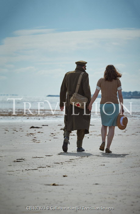 CollaborationJS A ww2 couple walking along a beach Couples