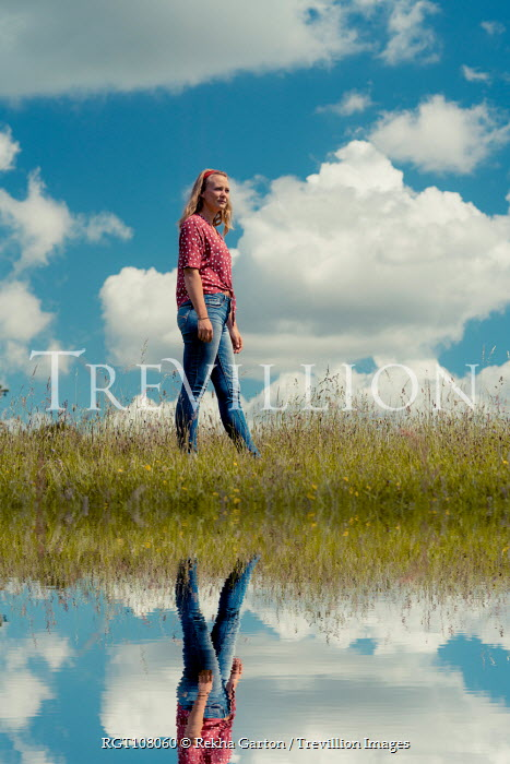 Rekha Garton GIRL IN SUMMERY COUNTRYSIDE REFLECTED IN WATER Women