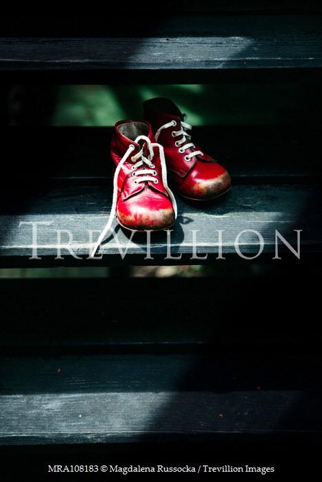 Magdalena Russocka child's red shoes left on wooden steps