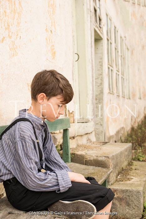 Galya Ivanova SAD BOY SITTING ON BENCH Children