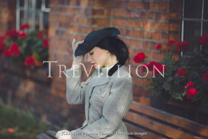 Joanna Czogala Retro woman touching hat Women