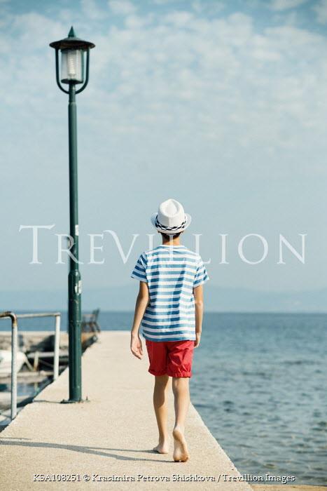 Krasimira Petrova Shishkova boy walking on jetty by the sea Children