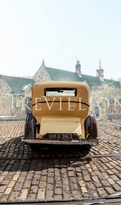 Stephen Mulcahey Back of yellow vintage car Cars