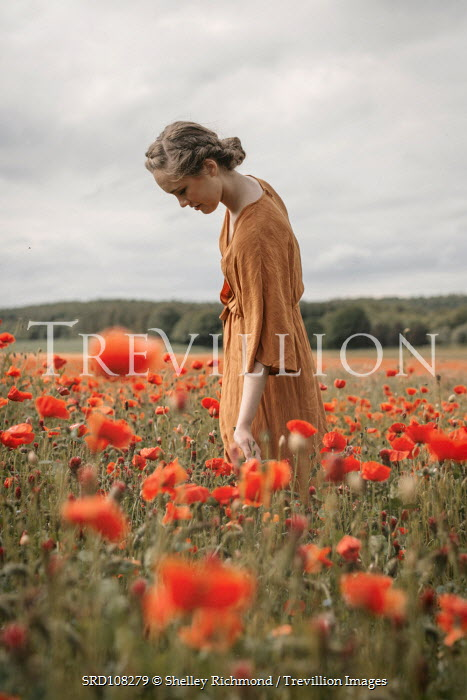 Shelley Richmond RETRO WOMAN TOUCHING POPPIES IN FIELD Women