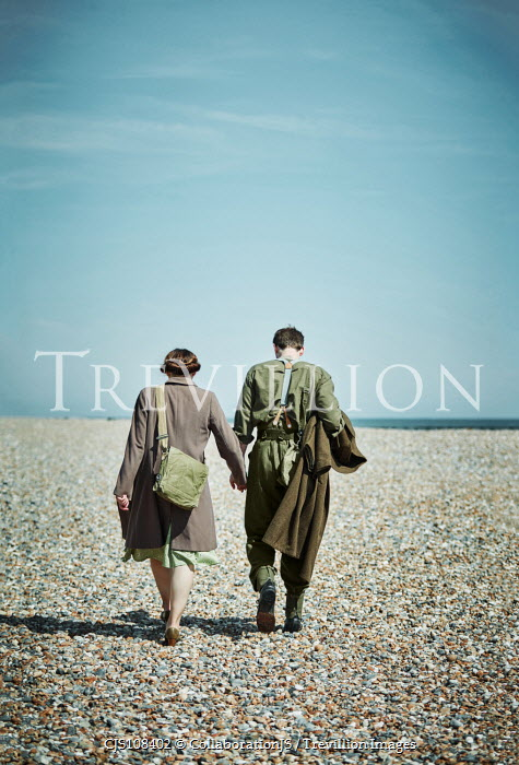 CollaborationJS A ww2 couple, walking aalong a pebble beach