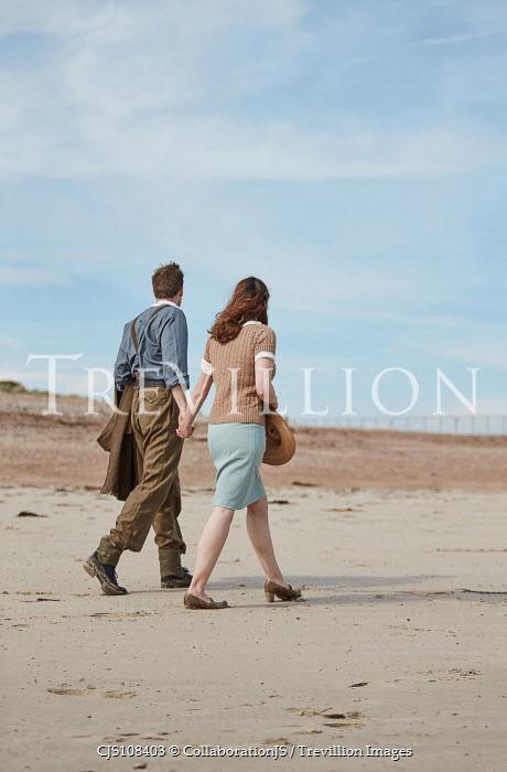 CollaborationJS A ww2 couple, walking along a beach