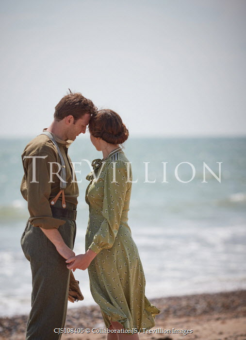 CollaborationJS A ww2, couple,  saying goodbye on a beach