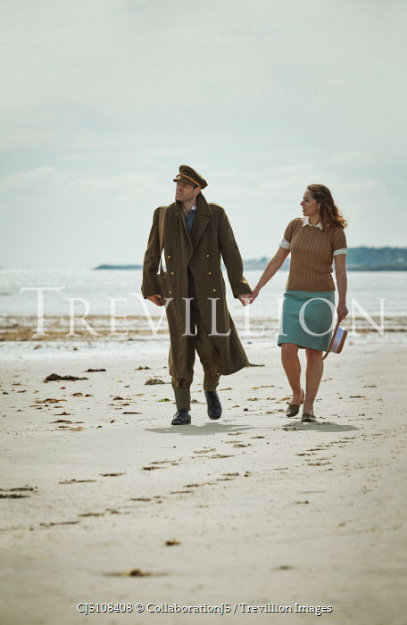 CollaborationJS A ww2 couple walking along a beach