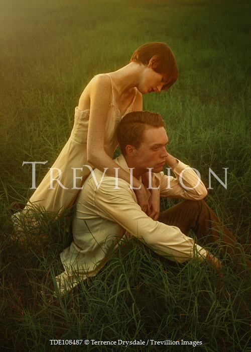 Terrence Drysdale INTIMATE RETRO COUPLE SITTING IN FIELD Couples