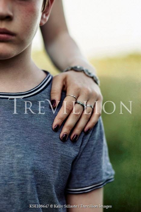 Kelly Sillaste Woman's hand on boy's shoulder