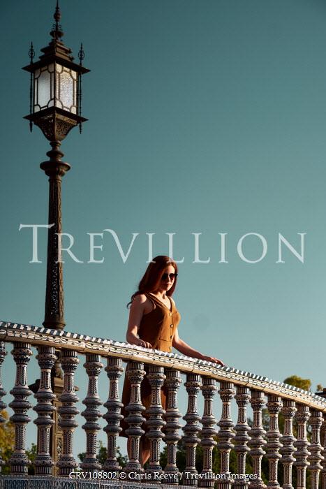 Chris Reeve Woman stood by streetlight and balcony Women