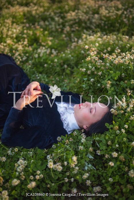 Joanna Czogala Historic woman lying in field Women