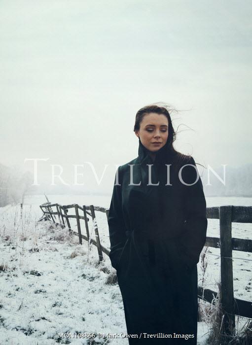 Mark Owen Woman stood in snowy countryside Women