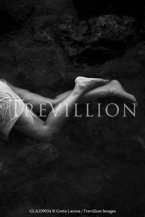 Greta Larosa Legs of young woman lying in water
