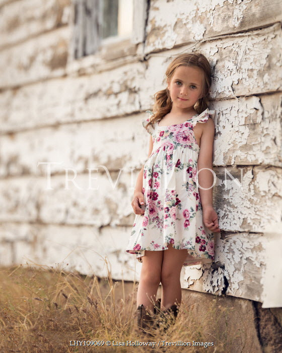 Lisa Holloway Girl in floral dress leaning on house with peeling paint