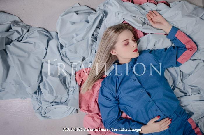 Dasha Pears Woman lying on fabrics on floor Women