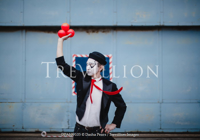 Dasha Pears Juggler with face painted holding balls Men