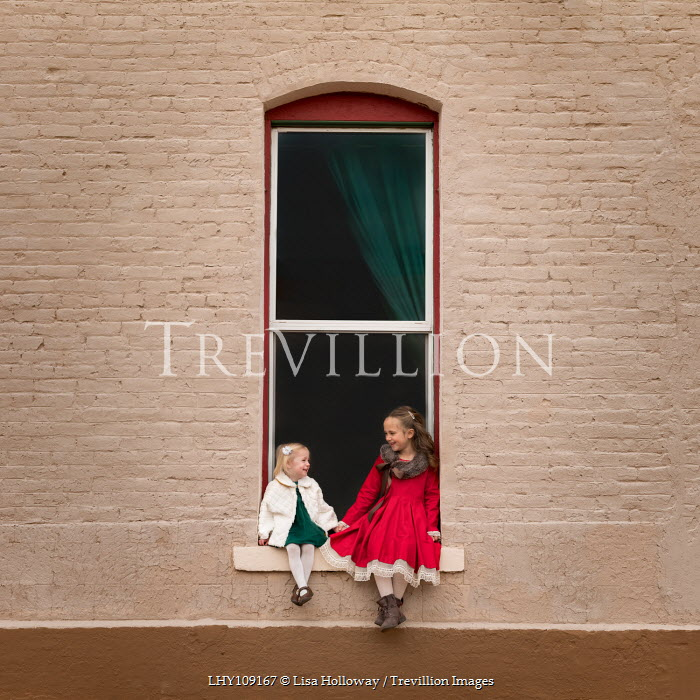 Lisa Holloway TWO HAPPY YOUNG GIRLS SITTING IN WINDOW Children