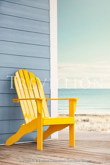 Evelina Kremsdorf YELLOW CHAIR ON PORCH BY SEA Seascapes/Beaches