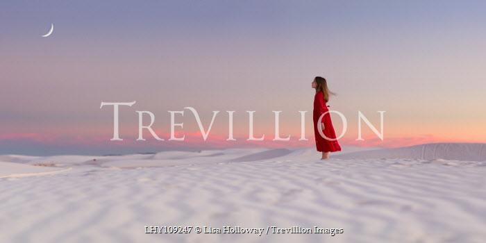 Lisa Holloway YOUNG GIRL STANDING IN DESERT AT SUNSET Children