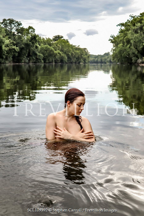 Stephen Carroll NUDE WOMAN IN RIVER WITH TREES Women