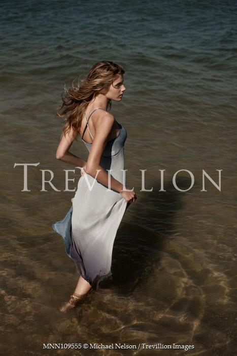 Michael Nelson Girl stood in shallow seawater Women