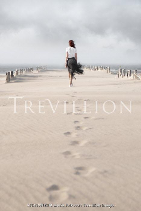Maria Petkova woman walking on sandy windy beach Women