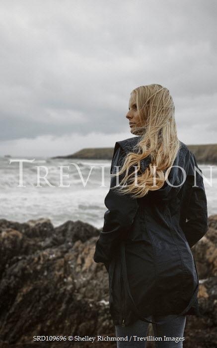 Shelley Richmond BLONDE WOMAN ON ROCKS BY WINDY SEA Women