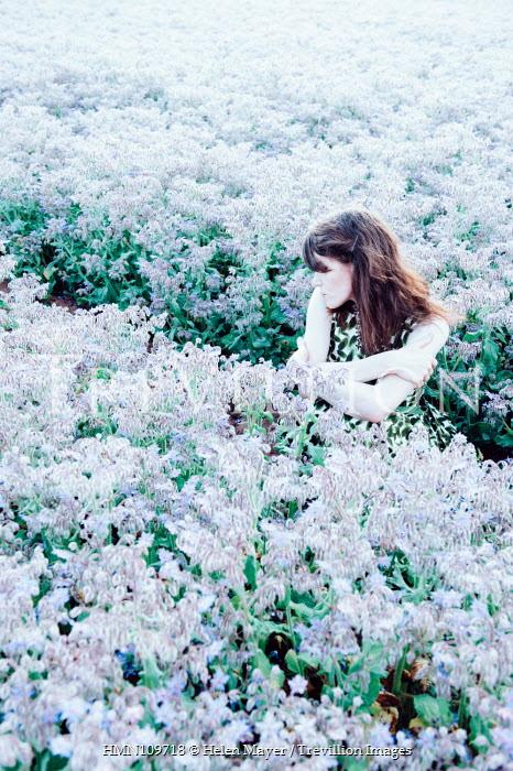 Helen Mayer SAD WOMAN SITTING IN FIELD OF FLOWERS Women