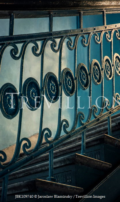 Jaroslaw Blaminsky CLOSE UP OF DECORATIVE BALUSTRADES IN OLD STAIRCASE Stairs/Steps