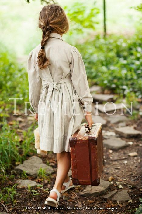 Kerstin Marinov Little girl walking in woods Children