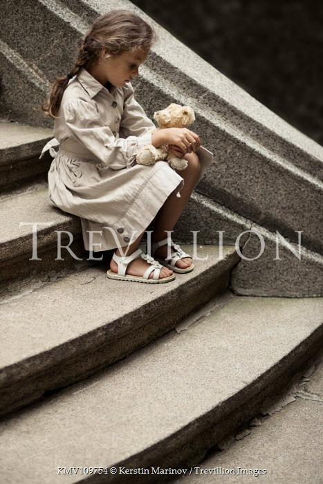 Kerstin Marinov Little girl sat on steps Children