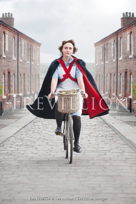 Lee Avison 1940s nurse cycling in street Women
