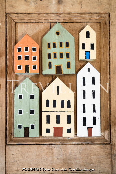 Peter Chadwick Model houses on wooden background Miscellaneous Objects