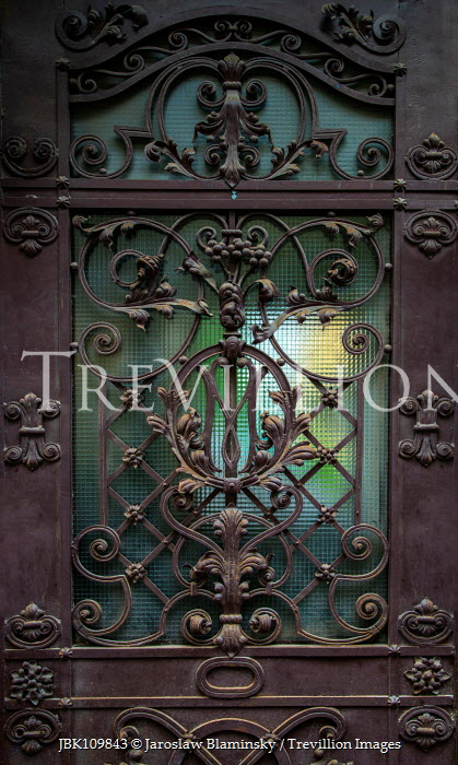 Jaroslaw Blaminsky Decorative gate on door window Building Detail
