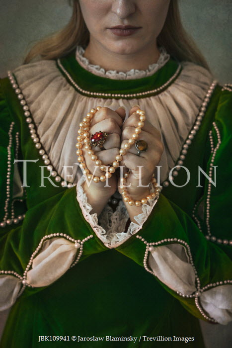 Jaroslaw Blaminsky Historic woman holding pearl beads Women