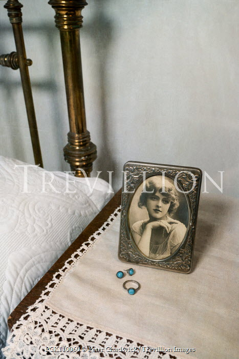 Peter Chadwick OLD PHOTOGRAPH WITH JEWELLERY ON BEDSIDE TABLE Interiors/Rooms