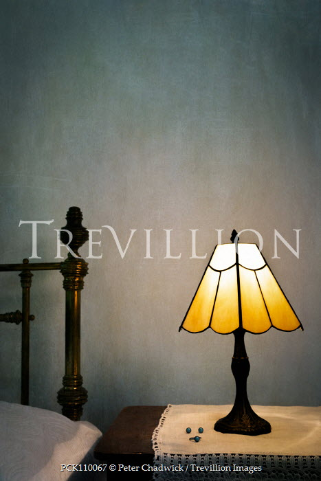 Peter Chadwick LAMP WITH JEWELLERY BY BED AT NIGHT Interiors/Rooms