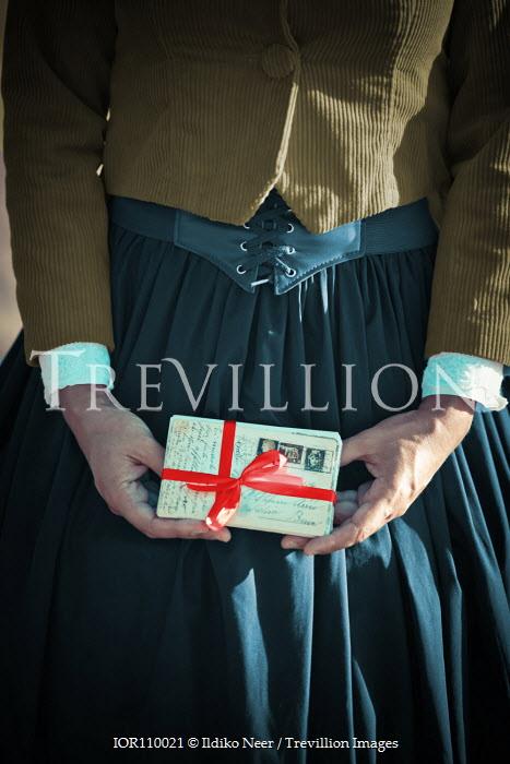Ildiko Neer Historical woman holding letters