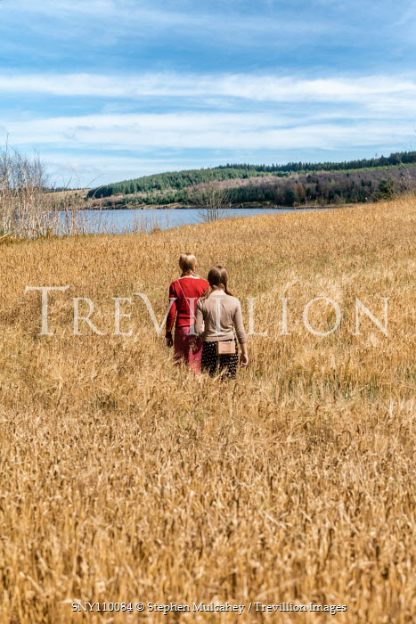 Stephen Mulcahey TWO GIRLS IN WHEAT FIELD BY LAKE Children