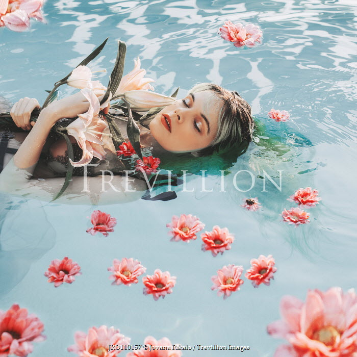Jovana Rikalo WOMAN FLOATING IN WATER WITH FLOWERS Women