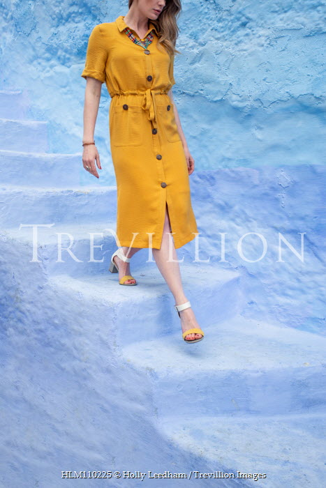 Holly Leedham WOMAN IN YELLOW DRESS WALKING DOWN STONE STEPS Women
