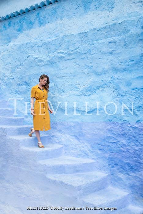 Holly Leedham WOMAN IN YELLOW DRESS WALKING DOWN STONE STEPS Women