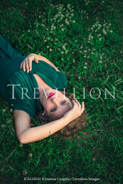 Joanna Czogala WOMAN LYING ON GRASS Women
